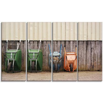 Designart Row of Wheelbarrows Landscape Photo Canvas Art Print - 4 Panels