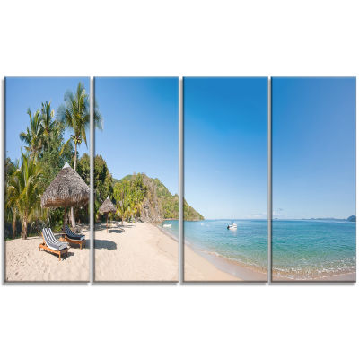 Designart Beach with Chairs and Umbrellas SeashorePhoto Canvas Print - 4 Panels