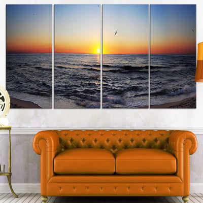 Designart Sunrise at Sea Panorama Photography Canvas Art Print - 4 Panels