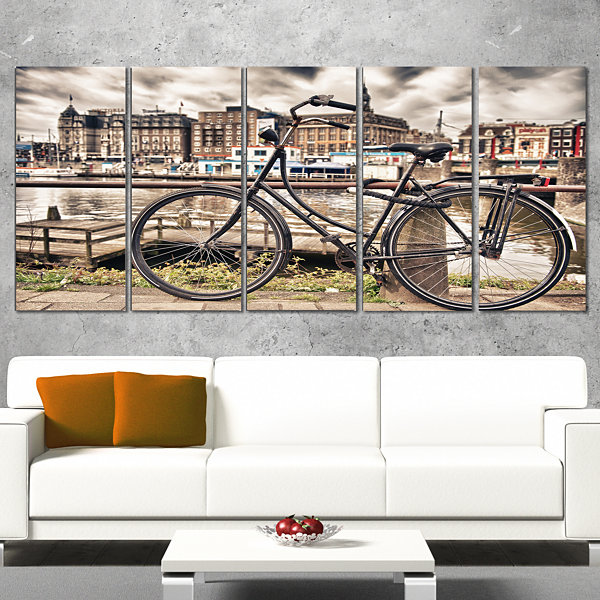 Designart Bike Over Bridge in Amsterdam CityscapePhoto Canvas Print - 5 Panels