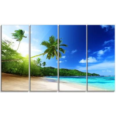 Designart Sunset Beach with Palm Landscape Photography Canvas Art Print - 4 Panels
