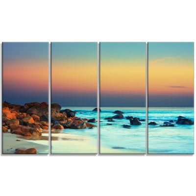Designart Sunset Over Blue Sky Seascape Photography Canvas Art Print - 4 Panels