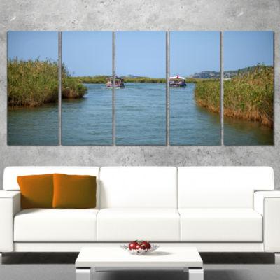 Designart Touristic River Boats Landscape Photography CanvasArt Print - 4 Panels