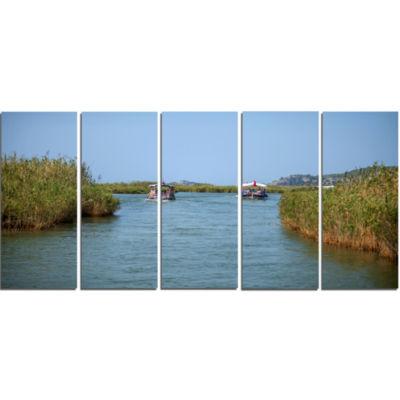 Designart Touristic River Boats Landscape Photography CanvasArt Print - 5 Panels