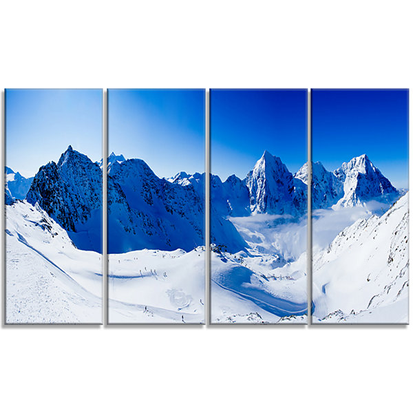 Designart Blue Winter Mountains Photography CanvasArt Print- 4 Panels