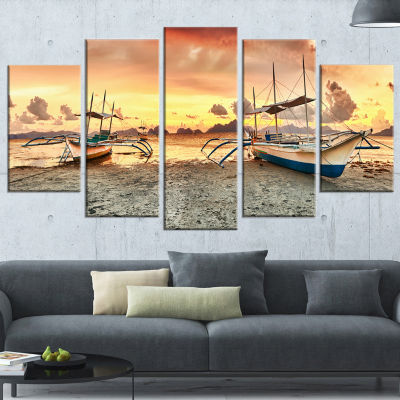 Designart Boats at Sunset Seashore Photography Wrapped Canvas Art Print - 5 Panels