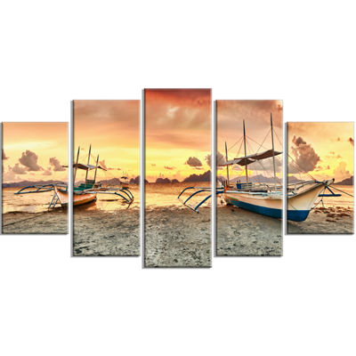 Designart Boats at Sunset Seashore Photography Canvas Art Print - 5 Panels