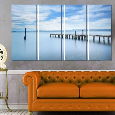 Designart Bright Sky and Blue Sea Seascape CanvasArt Print- 4 Panels