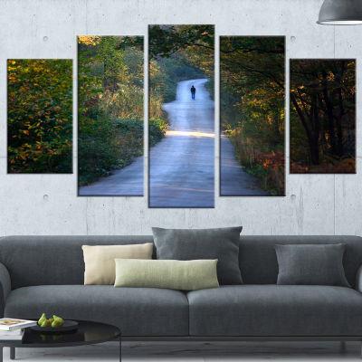 Designart Walking Alone on Road Landscape Photo Canvas Art Print - 5 Panels
