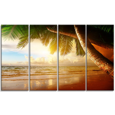 Designart Caribbean Beach Sunrise Landscape PhotoCanvas Art Print - 4 Panels