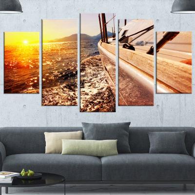 Designart Yacht Sailing Against Sunset Large Seashore CanvasWall Art - 4 Panels