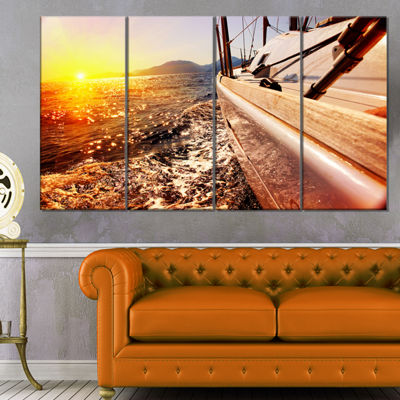 Designart Yacht Sailing Against Sunset Large Seashore CanvasWall Art - 4 Panels
