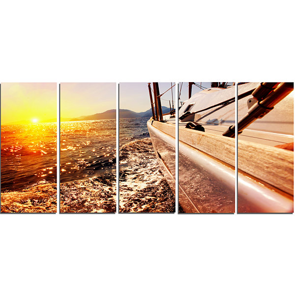 Designart Yacht Sailing Against Sunset Large Seashore CanvasWall Art - 5 Panels