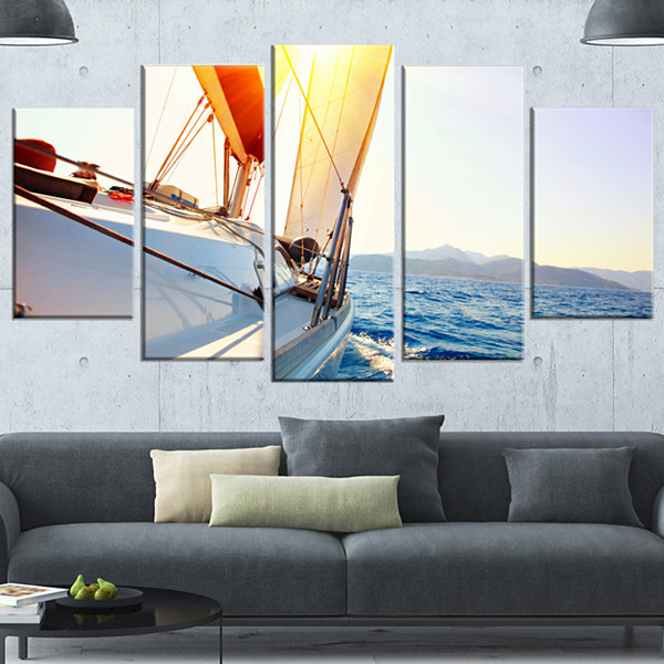 Designart Sailboat Sailing In The Blue Sea LargeSeashore Canvas Wall Art - 4 Panels