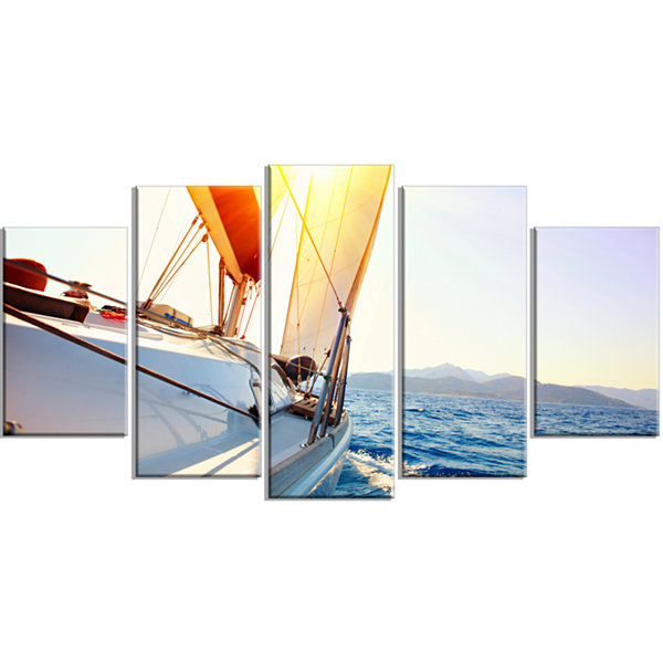 Designart Sailboat Sailing In The Blue Sea LargeSeashore Wrapped Canvas Wall Art - 5 Panels