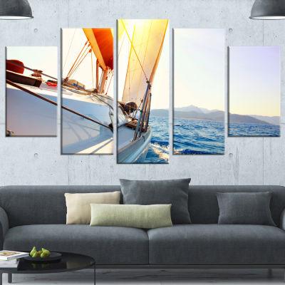 Designart Sailboat Sailing In The Blue Sea LargeSeashore Canvas Wall Art - 5 Panels