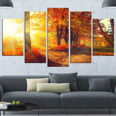 Designart Autumnal Trees In Sunrays Large Landscape Canvas Art Print - 4 Panels