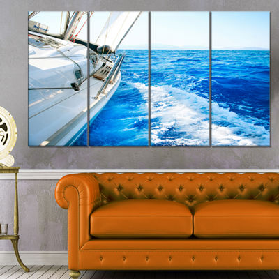 Designart White Sailing Yacht In Blue Sea Large Seashore Canvas Wall Art - 4 Panels