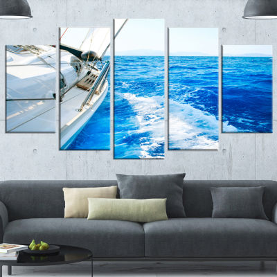 Designart White Sailing Yacht In Blue Sea Large Seashore Wrapped Canvas Wall Art - 5 Panels