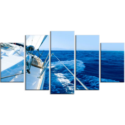 Designart Tourism Yacht Sailing In Blue Sea LargeSeashore Wrapped Canvas Wall Art - 5 Panels