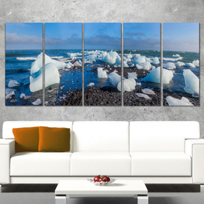 Designart Ice Blocks On Sand Beach Seashore PhotoCanvas Art Print - 5 Panels