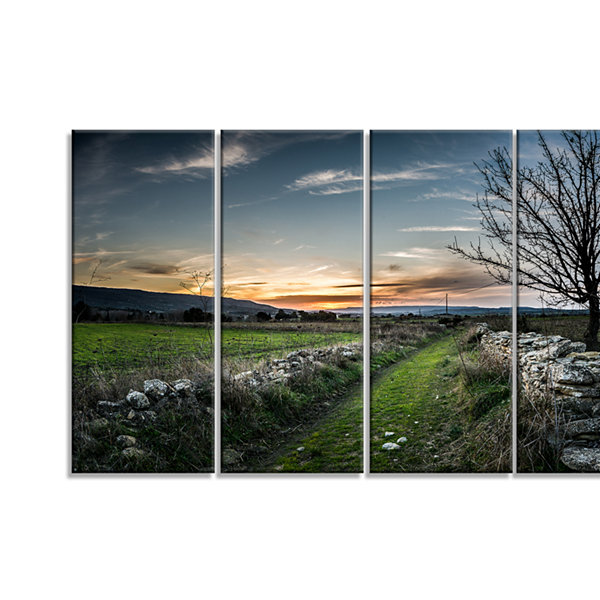 Designart Rocky Fences In Green Grassland Extra Large Landscape Canvas Art Print - 4 Panels