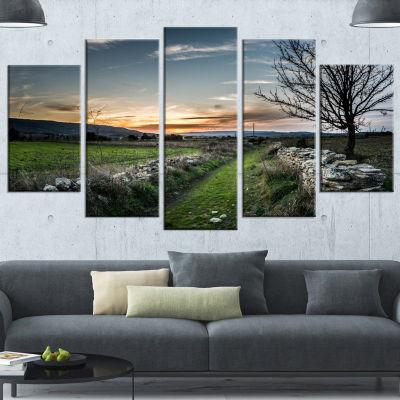 Designart Rocky Fences In Green Grassland Extra Large Landscape Wrapped Canvas Art Print - 5 Panels