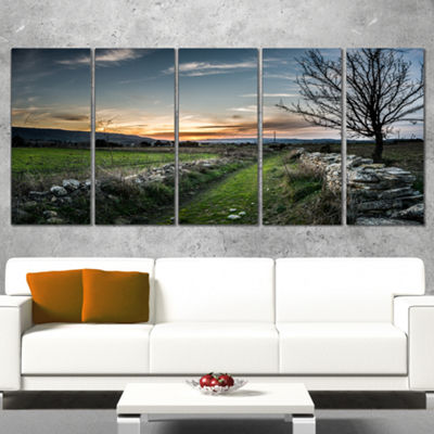 Designart Rocky Fences In Green Grassland Extra Large Landscape Canvas Art Print - 5 Panels