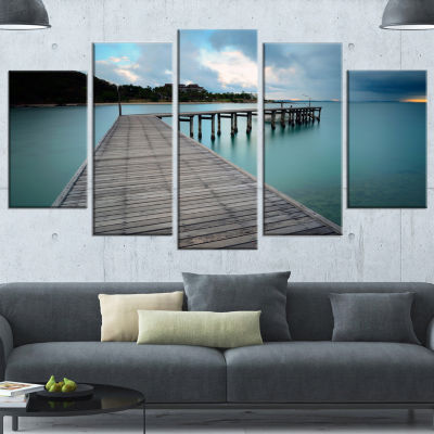 Designart Wooden Bridge To Calm Ocean Modern Wrapped Canvas Art Print - 5 Panels