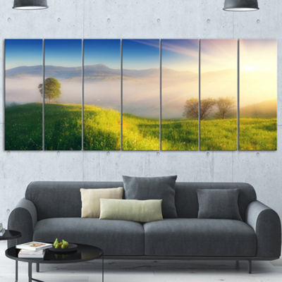 Designart Morning Mist Over Mountain Village ExtraLarge Landscape Canvas Art Print - 7 Panels