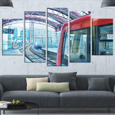 Designart Departing London Subway Train Modern Cityscape Canvas Art Print - 4 Panels