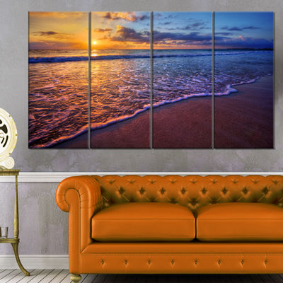 Designart Sunset Over Blue Seashore Seashore PhotoCanvas Art Print - 4 Panels