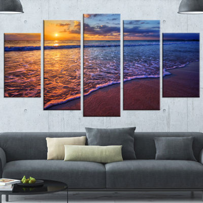 Designart Sunset Over Blue Seashore Seashore PhotoCanvas Art Print - 5 Panels