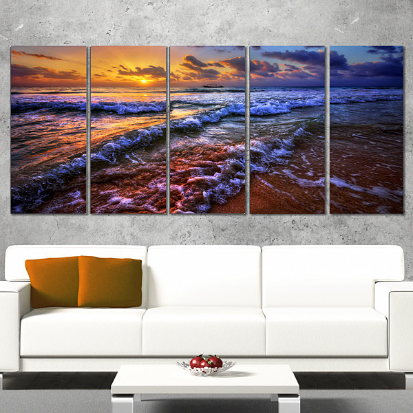 Designart Sunset Over Blue Tinged Waves SeashorePhoto Canvas Art Print - 5 Panels