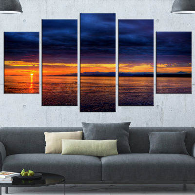 Designart Blue Cloudy Sky And Setting Sun SeashorePhoto Canvas Art Print - 4 Panels