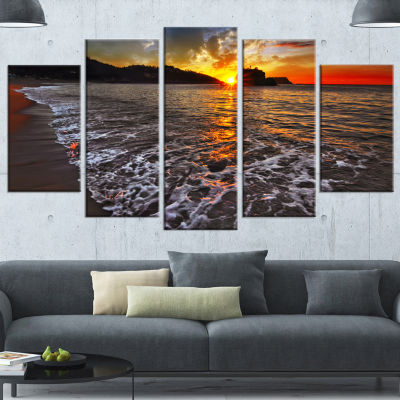 Designart Setting Sun And White Waves Seashore Photo Wrapped Canvas Art Print - 5 Panels