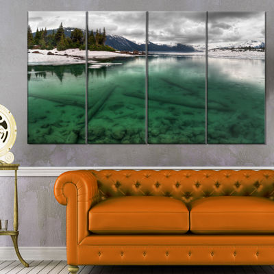 Designart Crystal Clear Lake And Mountains ExtraLarge Landscape Canvas Art Print - 4 Panels