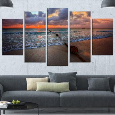 Designart Reddish Sunset Over Clear Beach SeashoreCanvas Art Print - 4 Panels