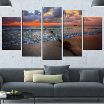 Designart Reddish Sunset Over Clear Beach SeashoreWrapped Canvas Art Print - 5 Panels