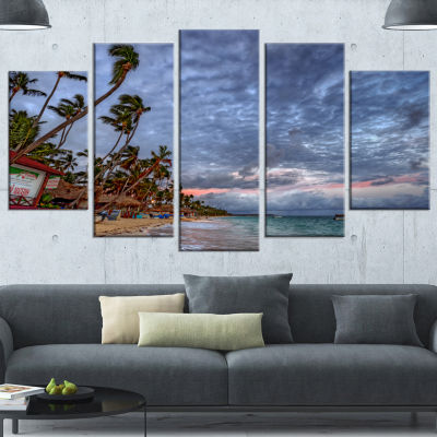 Designart Long Palm Trees Bent To Beach SeashoreCanvas Art Print - 4 Panels