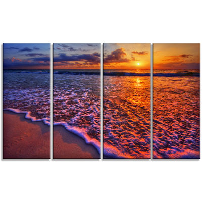 Designart Colorful Sunset And Wavy Waters SeashoreCanvas Art Print - 4 Panels