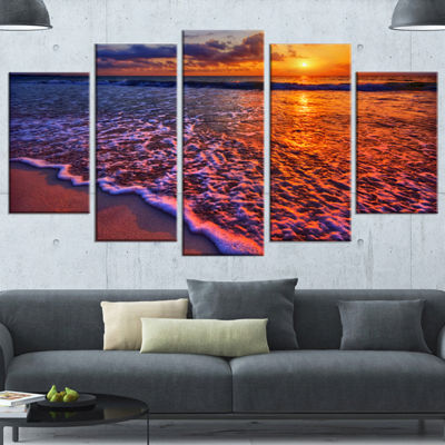 Designart Colorful Sunset And Wavy Waters SeashoreWrapped Canvas Art Print - 5 Panels