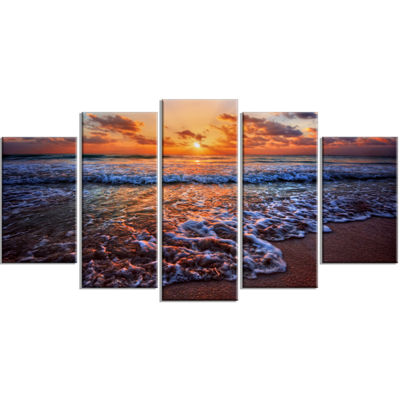 Designart Roaring Sea Wavers During Sunset Seashore Wrapped Canvas Art Print - 5 Panels