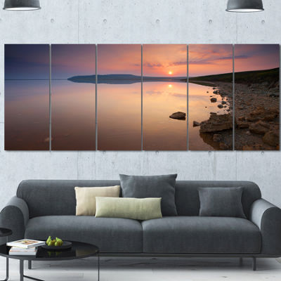 Designart Beautiful Sunrise Over Tranquil Sea Seashore Canvas Art Print - 6 Panels