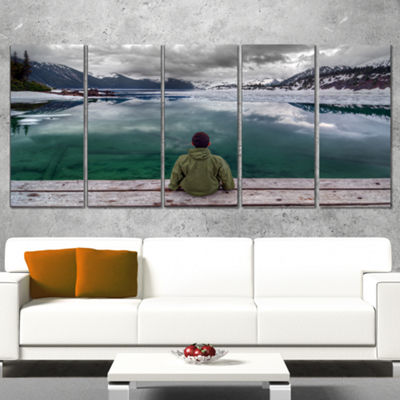 Designart Boy Looking At Clear Mountain Lake Landscape Canvas Art Print - 5 Panels