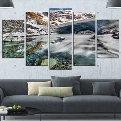 Designart Cave In Rugged Rocky Setting LandscapeCanvas Art Print - 5 Panels