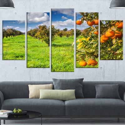 Designart Bright Green Grass In Orange Garden Large Landscape Canvas Art Print - 4 Panels