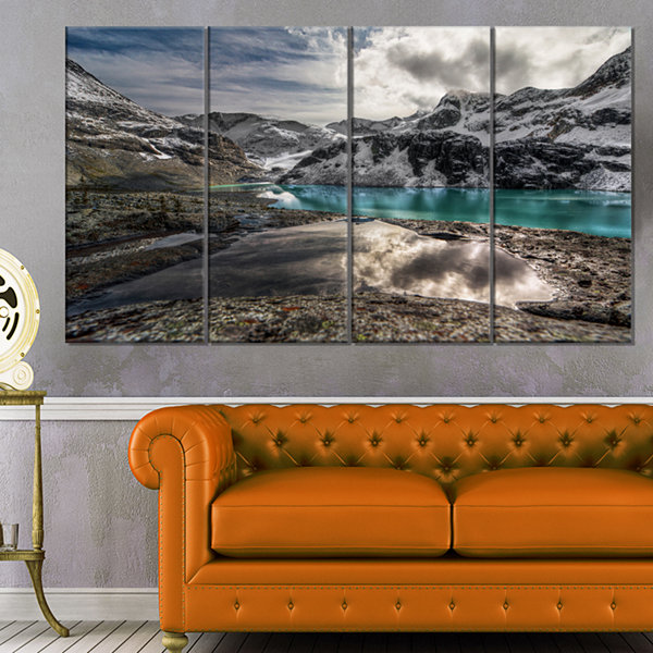 Designart Mountain Creek Under Cloudy Sky Large Landscape Canvas Art Print - 4 Panels