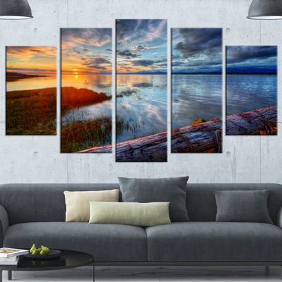 Designart Colorful River Sunset With Log Large Seashore Canvas Art Print - 5 Panels