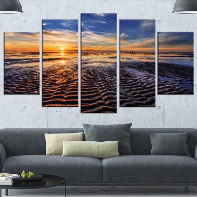 Designart Waves On The Sand During Sunset SeashoreCanvas Art Print - 4 Panels